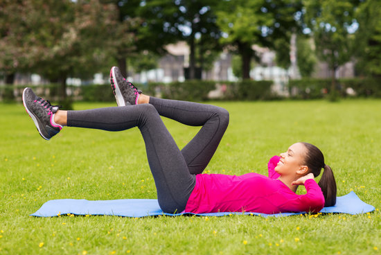 Woman Doing Exercises on Mat Outdoors