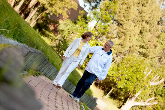 Retired Couple Walking Outdoors