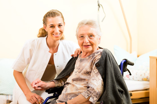 Young Nurse and Female Senior in Nursing Home