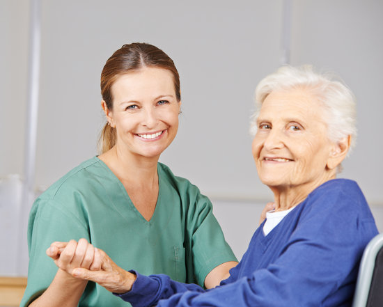 Old Woman with Geriatric Nurse in Nursing Home