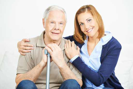 Woman with Senior Man in Nursing Home
