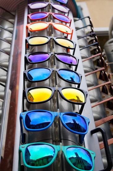 Skyscraper of Cheap Plastic Sunglasses for Sale. Mirror Style.