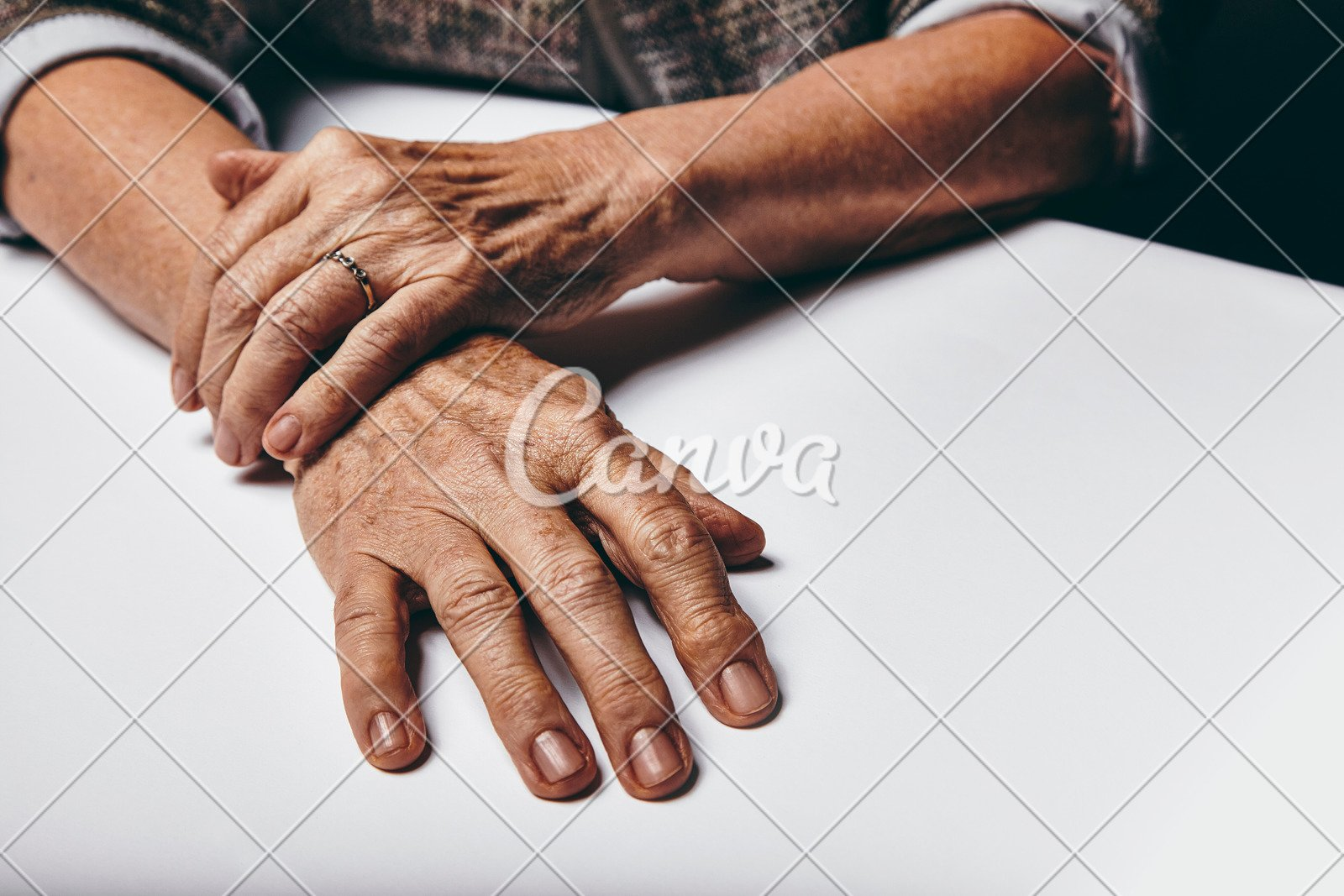 Old Female Hands on Table - Photos by Canva
