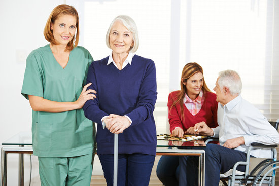 Caregiver with Senior People in Nursing Home