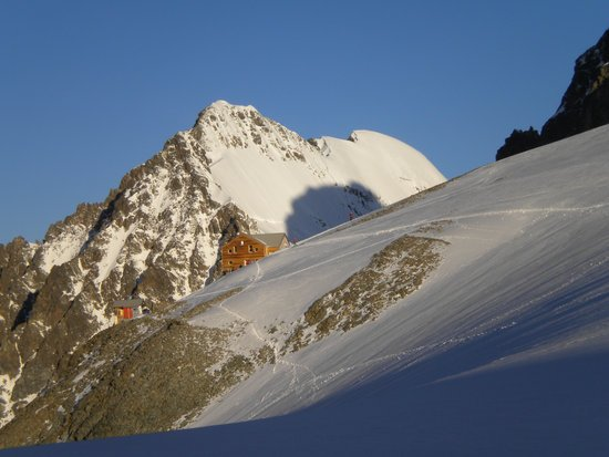 mountain hut in the Swiss Alps on a high alpine glacier at dawn