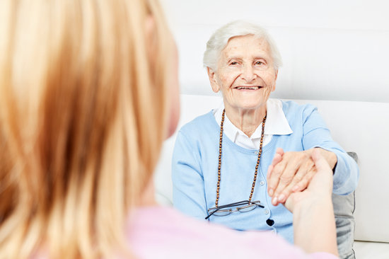 Nurse on Home Visit with a Senior Citizen