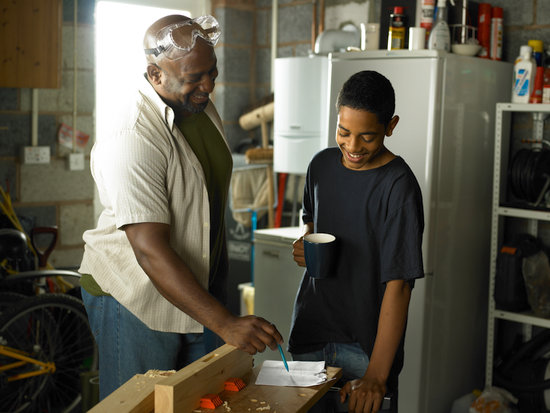 Father and Son looking at DIY plans