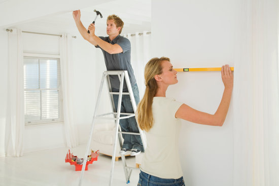 Couple working on DIY projects
