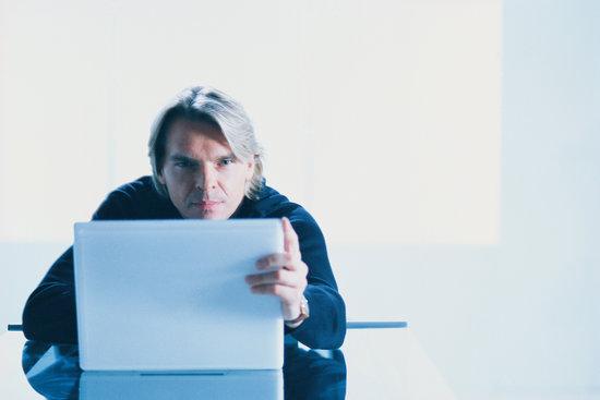 Man gripping laptop