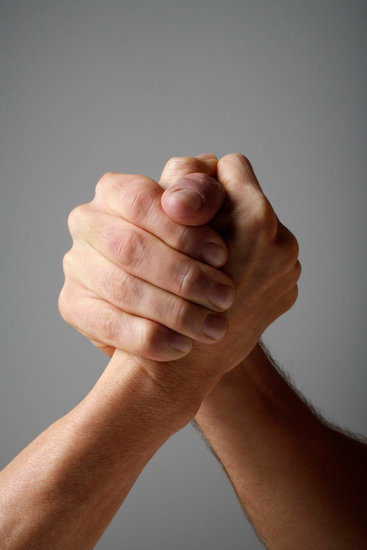 Two hands locked in grip