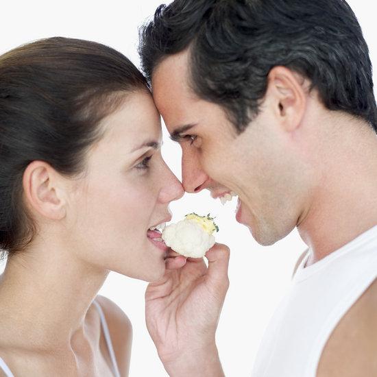 couple sharing a piece of cauliflower
