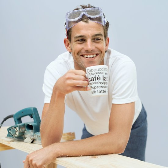man doing diy and drinking coffee