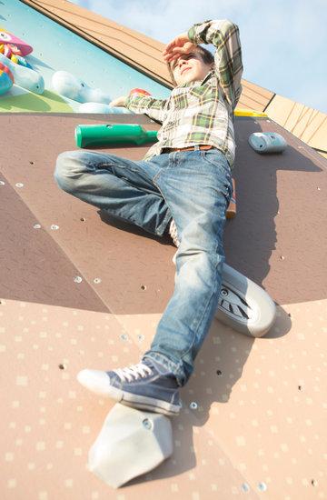 Child Climb a Climbing Wall