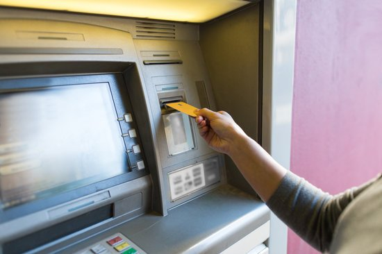 Close up of Woman Inserting Card to Atm Machine