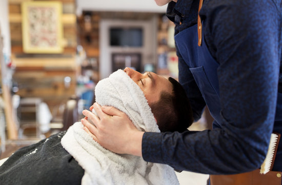 Barber Softening Male Face with Hot Towel