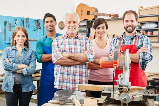 Successful Interracial Luthier's Team