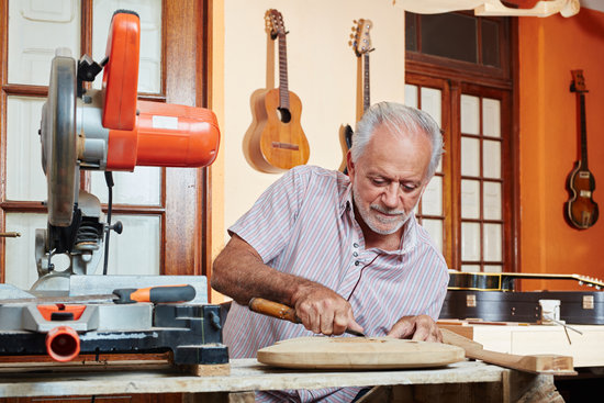 Guitar Maker or Luthier Working
