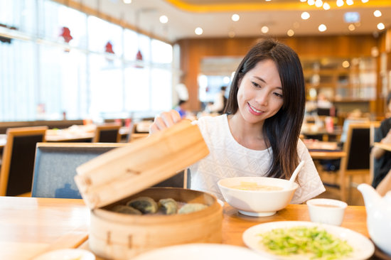 Woman Open the Bamboo Steamer