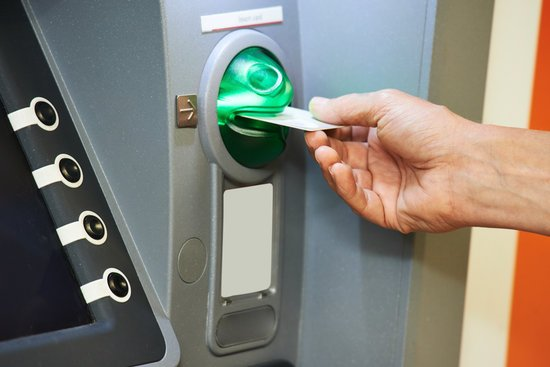 Inserting Plastic Card into ATM