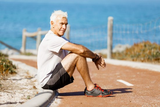 Man in Sports Wear Sitting at the Beach