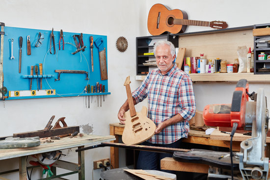 Luthier Showing New Guitar