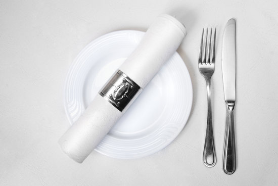 Knife, Fork, Plate and Napkin in Restaurant