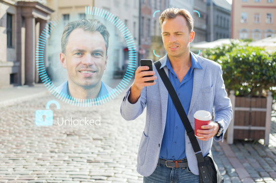 Man Unlock His Mobile Phone with Facial Recognition and Authentication Technology