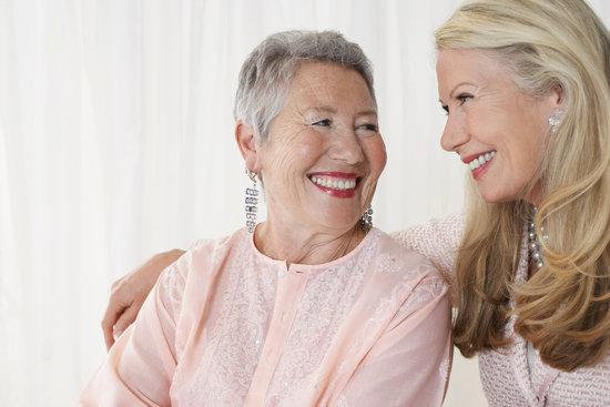 Two elegant senior woman in studio half length