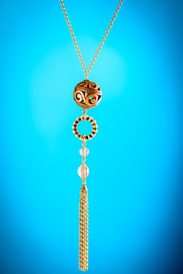 Cheap metal pendant necklace from bazaar on blue background