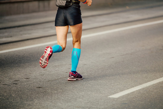 f7cce0c72 women legs runner athlete in bright blue compression socks