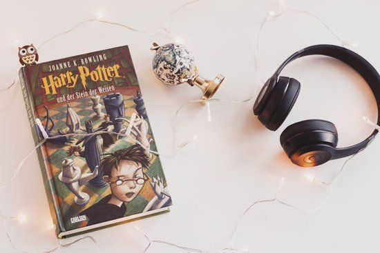 Harry Potter Book and Black Headphones With Trinket