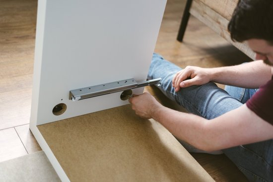 Photo of Man Assembling Furniture