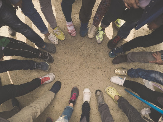 Top View of Feet of People Standing in a Circle. Runners Standin