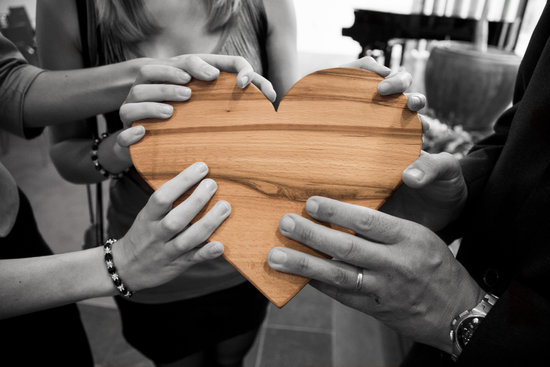Selective Focus Photography of Group of Person Holding Wood Heart