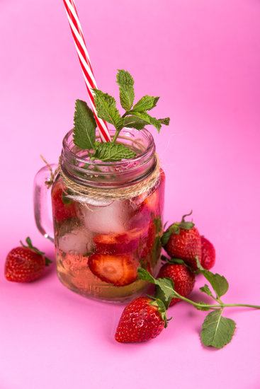 Clear Glass Jar With Water and Strawberries