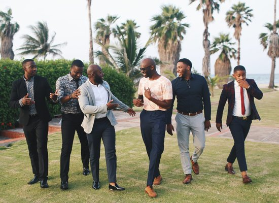 Six Men Standing While Laughing