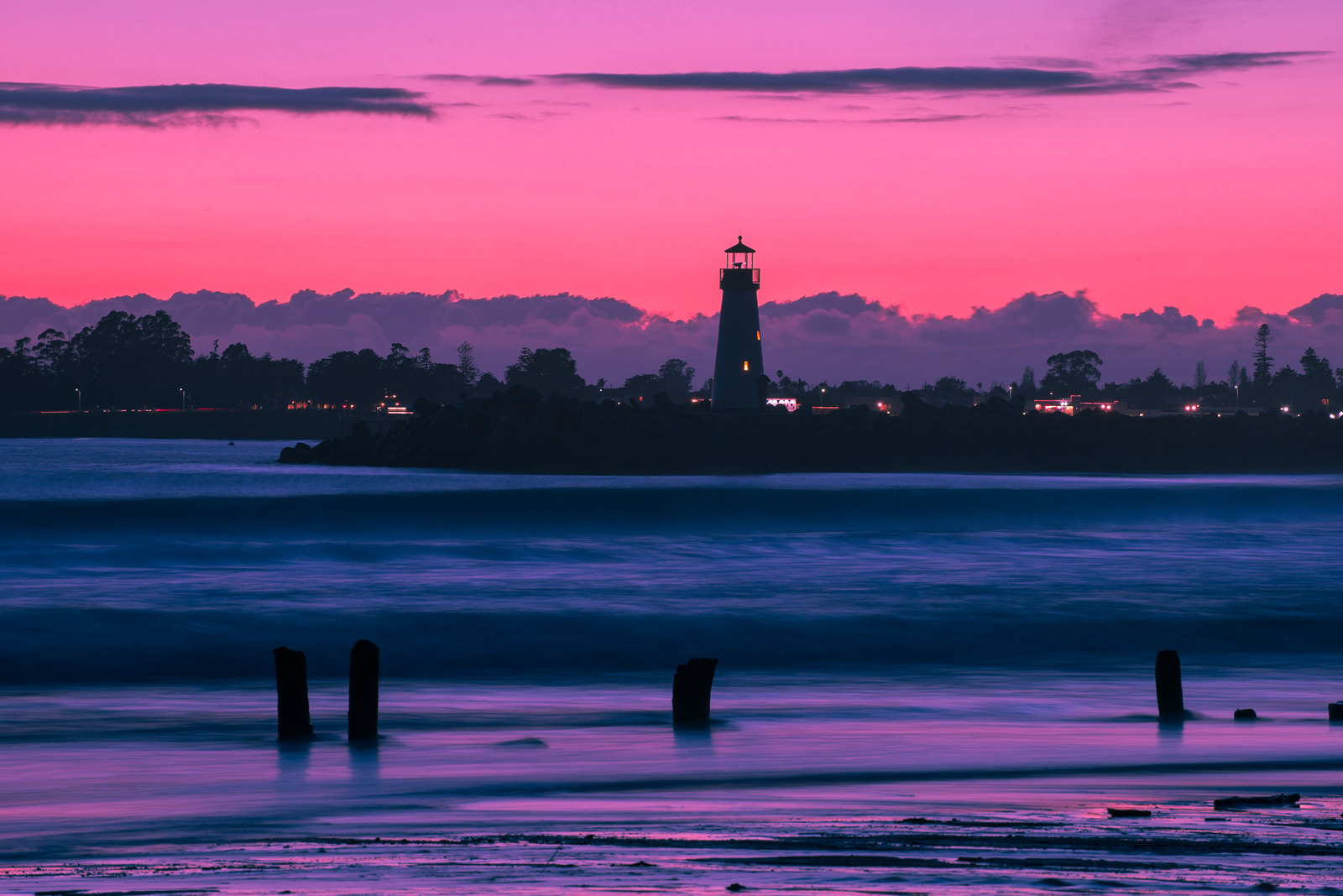 Lighthouse during Night - Photos by Canva