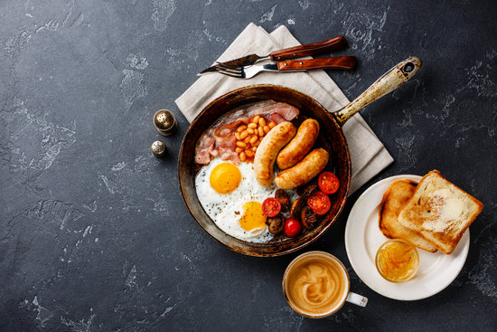 English Breakfast in Cooking Pan with Fried Egg, Sausage, Bacon,