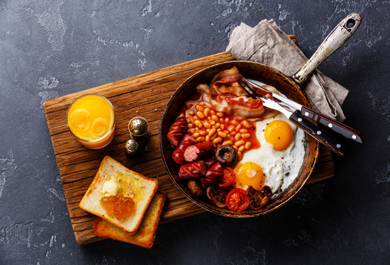 English Breakfast in Cooking Pan with Fried Eggs, Sausages, Baco