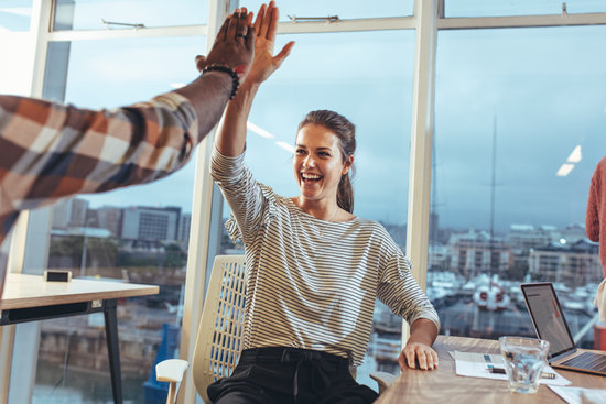 Coworkers Celebrating Success in Office