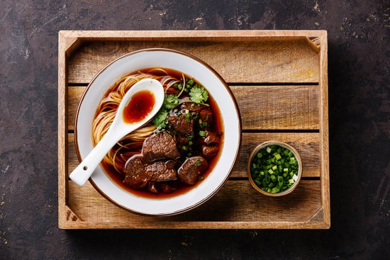 Asian Noodles in Broth with Slow Cooked Beef in Wooden Tray on D