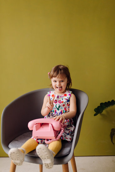 Happy Laughing Child Girl with Telephone