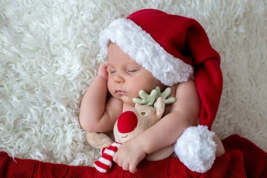 58c0feb13 Little sleeping newborn baby boy, wearing Santa hat