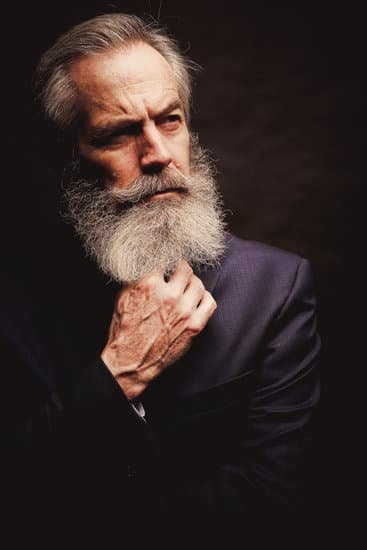 58806557d mature male model wearing suit with grey hairstyle and beard