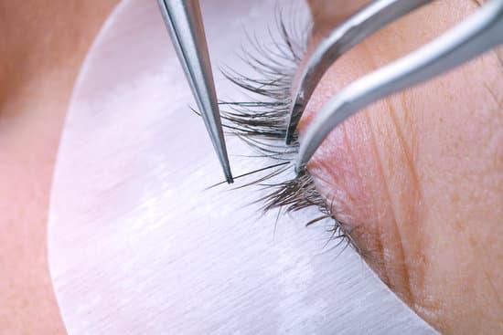 f0dd21a852c Eyelash extension procedure, woman eye with Long eyelashes